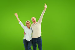 Composite image of happy mature couple cheering at camera Stock Photo