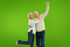 Composite image of happy mature couple cheering at camera Stock Photos