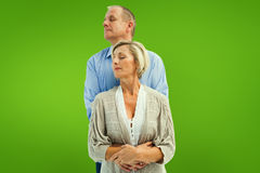 Composite image of happy mature couple embracing with eyes closed Royalty Free Stock Image