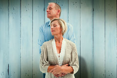Composite image of happy mature couple embracing with eyes closed Royalty Free Stock Images