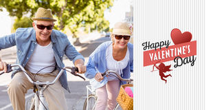 Composite image of happy mature couple going for a bike ride in the city Stock Images