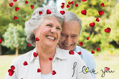 Composite image of happy mature couple laughing Royalty Free Stock Photo