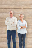 Composite image of happy mature couple smiling at camera Stock Photography