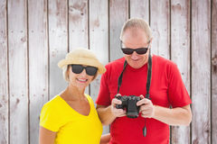 Composite image of happy mature couple wearing sunglasses Stock Photos