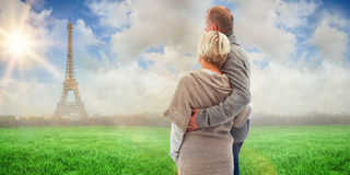 Composite image of happy mature couple in winter clothes Royalty Free Stock Photography