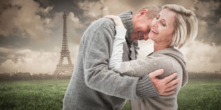 Composite image of happy mature couple in winter clothes Royalty Free Stock Images