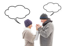 Composite image of happy mature couple in winter clothes embracing Royalty Free Stock Image