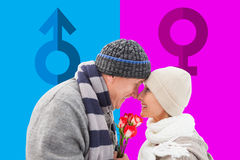 Composite image of happy mature couple in winter clothes with roses Royalty Free Stock Images