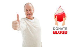 Composite image of happy mature man showing thumbs up to camera Stock Photo