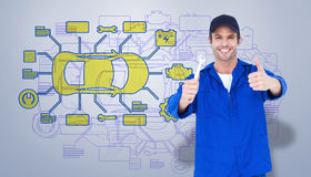 Composite image of happy mechanic holding spanner Royalty Free Stock Photography