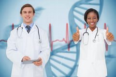 Composite image of happy medical team Stock Photo