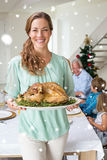 Composite image of happy mother with christmas meal Stock Photo