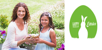 Composite image of happy mother and daughter collecting easter eggs Royalty Free Stock Photography
