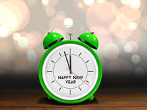 Composite image of happy new year in green alarm clock Stock Image