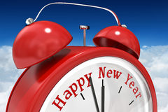 Composite image of happy new year in red alarm clock Royalty Free Stock Photo
