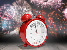 Composite image of happy new year in red alarm clock. Happy new year in red alarm clock against wooden planks Royalty Free Stock Photos