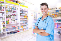 Composite image of happy nurse looking at camera with arms crossed Royalty Free Stock Photos