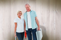 Composite image of happy older couple holding diy tools Stock Photo
