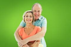 Composite image of happy older couple holding paint roller Royalty Free Stock Photos
