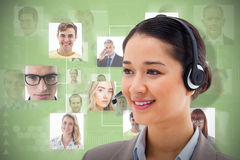 Composite image of happy operator posing with a headset Royalty Free Stock Image