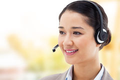 Composite image of happy operator posing with a headset Stock Photo