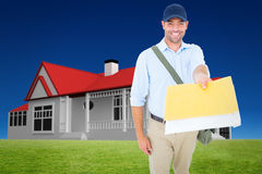 Composite image of happy postman delivering letter on white background Stock Photo