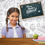 Composite image of happy pupil Royalty Free Stock Photography
