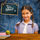 Composite image of happy pupil Stock Images