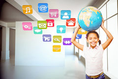 Composite image of happy pupil holding globe Stock Photography