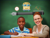 Composite image of happy pupil and teacher. Happy pupil and teacher against green chalkboard Stock Image