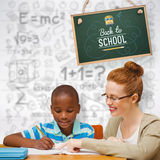 Composite image of happy pupil and teacher. Happy pupil and teacher against grey background Stock Image