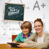 Composite image of happy pupil and teacher. Happy pupil and teacher against grey background Royalty Free Stock Photography