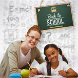 Composite image of happy pupil and teacher. Happy pupil and teacher against grey background Stock Photo