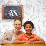Composite image of happy pupil and teacher. Happy pupil and teacher against grey background Royalty Free Stock Images