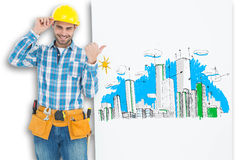 Composite image of happy repairman pointing towards blank billboard Royalty Free Stock Photos