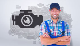 Composite image of happy repairman standing arms crossed on white background Royalty Free Stock Photography