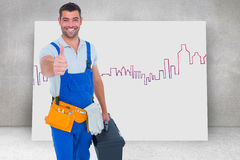 Composite image of happy repairman with toolbox gesturing thumbs up Royalty Free Stock Photo