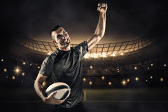 Composite image of happy rugby player punching the air Stock Photo