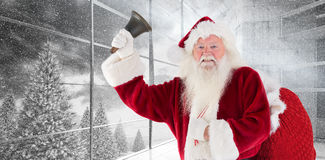 Composite image of happy santa ringing a bell Stock Image