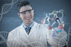 Composite image of happy scientist experimenting molecule structure Stock Photo