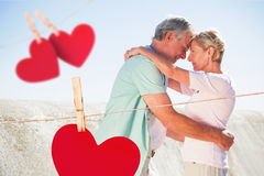 Composite image of happy senior couple embracing on the pier Royalty Free Stock Image