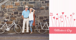 Composite image of happy senior couple going for a bike ride in the city Royalty Free Stock Images