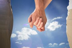 Composite image of happy senior couple holding hands Stock Photography