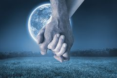 Composite image of happy senior couple holding hands Royalty Free Stock Photos