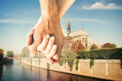 Composite image of happy senior couple holding hands Royalty Free Stock Images