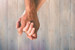 Composite image of happy senior couple holding hands Royalty Free Stock Image
