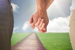 Composite image of happy senior couple holding hands Royalty Free Stock Photo