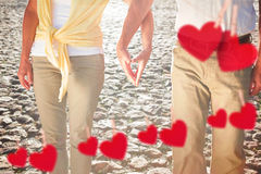 Composite image of happy senior couple touching hands Stock Image