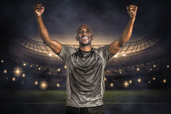 Composite image of happy sportsman with clenched fist after victory Stock Photography