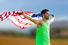 Composite image of happy sportsman holding a american flag Royalty Free Stock Image